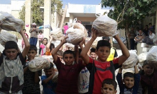 Yezedi Kids carrying Bread to their families