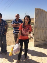 Grateful young woman takes supplies home to her family